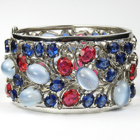 Dujay Sterling Ruby Sapphire and Blue Moonstone Cabochons Openwork Floral Tracery Bangle Bracelet
