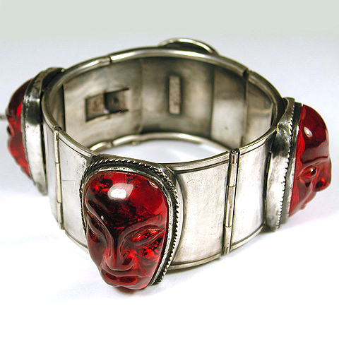 Sandor Carved Ruby Balinese Heads Bangle Bracelet